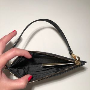 19e89bb47220 Michael Kors Bags - Black Michael Kors Frame Out Wristlet